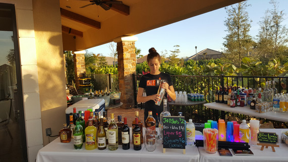 Chef Mike SRQ Bartender makes a cocktail.