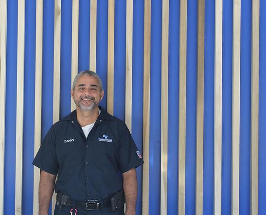 Danny Garza, team member at DreamWorks Air Conditioning, smiles.