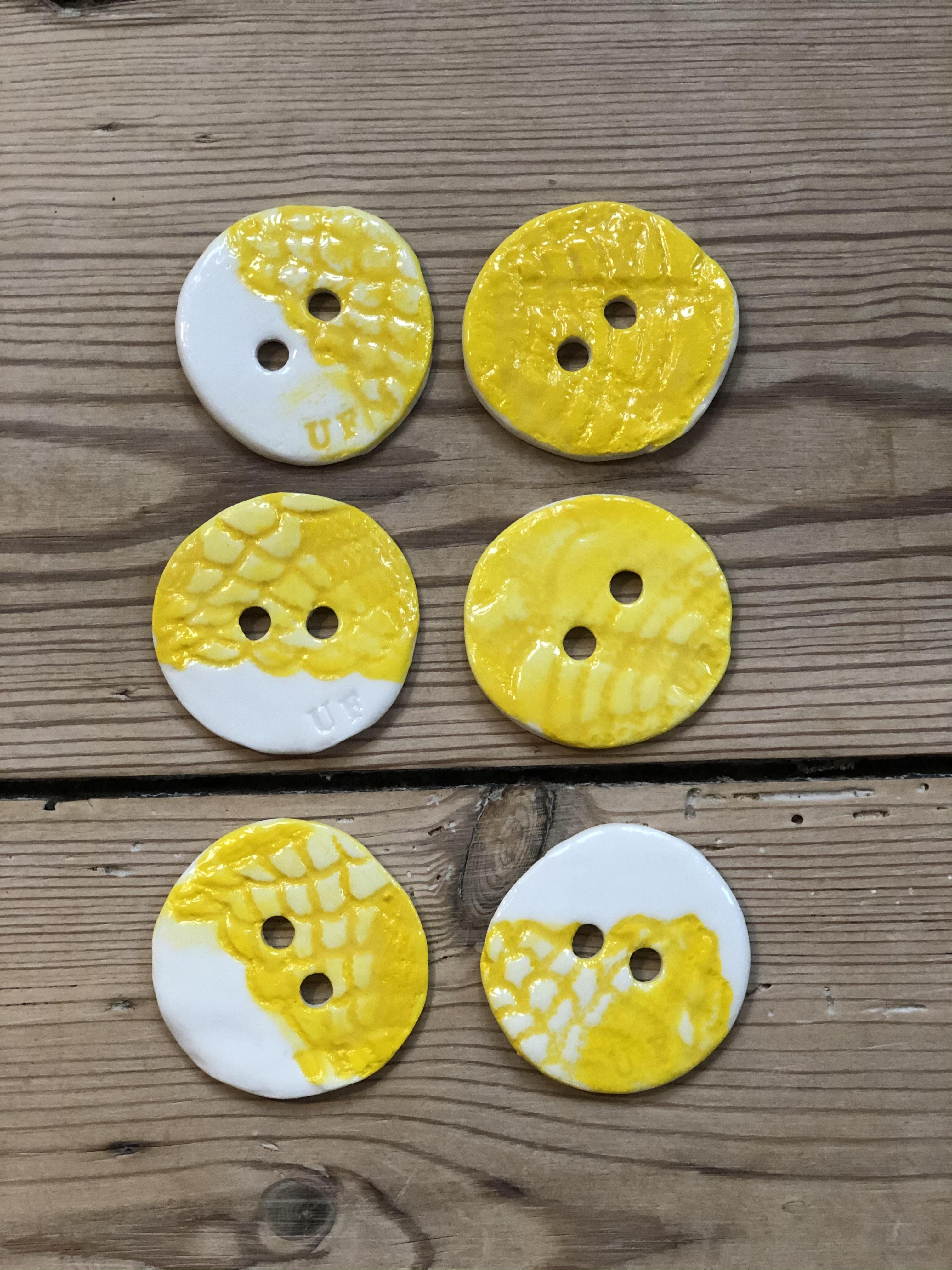 Hårknapper gul