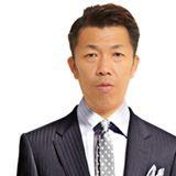 塚崎健治 氏
