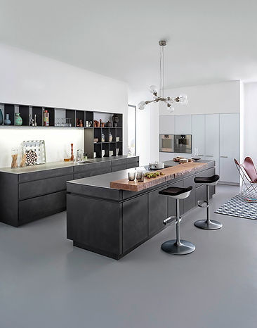 Sleek modern galley kitchen layout with handleless LEICHT cabinets.