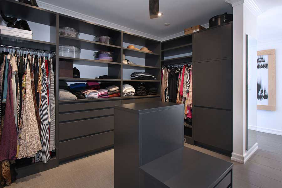 "LEICHT's wardrobe closet system has 1 1/8"" shelving to create openings up to 4' without the shelf backing. The handle-less drawers feature interior LED lighting for illumination."