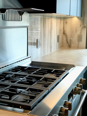 Design of the range front edge is exactly aligned with the adjacent countertop.