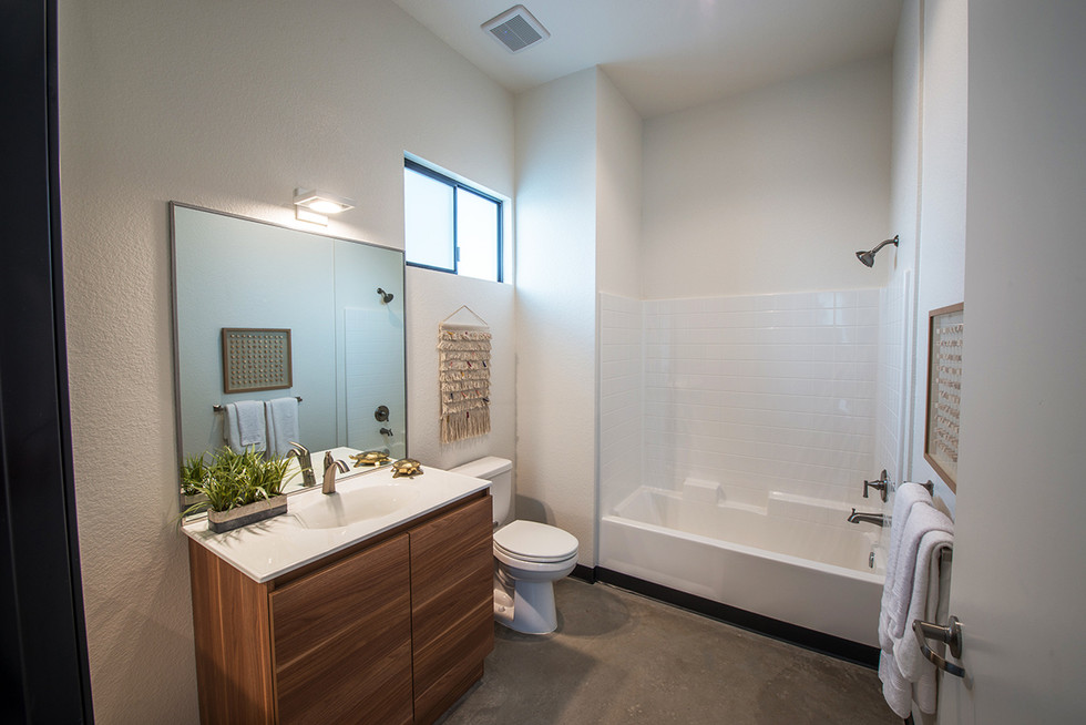The cabinets were modified to accomodate the countertop the contractor chose. Like the kitchen, a LEICHT countertop with built-in sink was used for time efficiency.