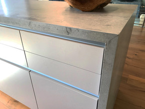 The waterfall countertop is mitered at a 45 degree cut.