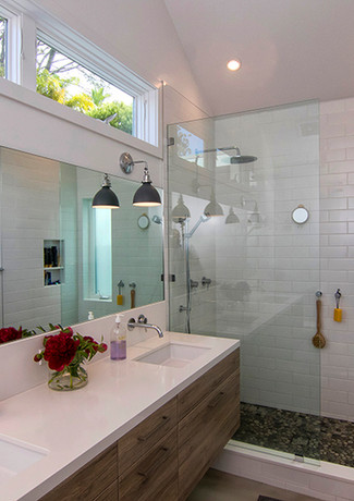 Open concept features floating cabinets makes the bathroom bigger. Under-cabinet accent lighting helps to find your way in the dark.