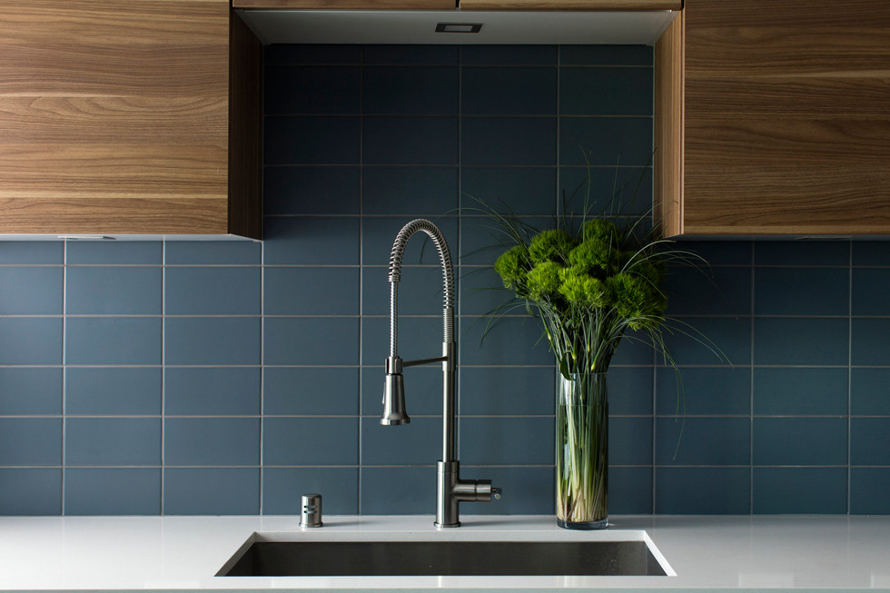 The LEICHT countertops with built-in sink are manufacured in Germany and delivered, ready to install, with the cabinetry, saving valuable production time.