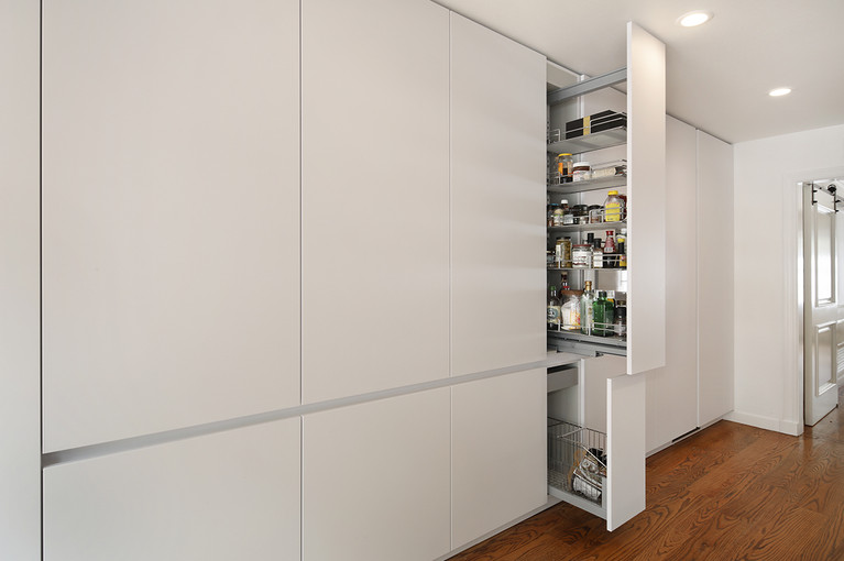 Pull-out pantries are a better functional approach to design.