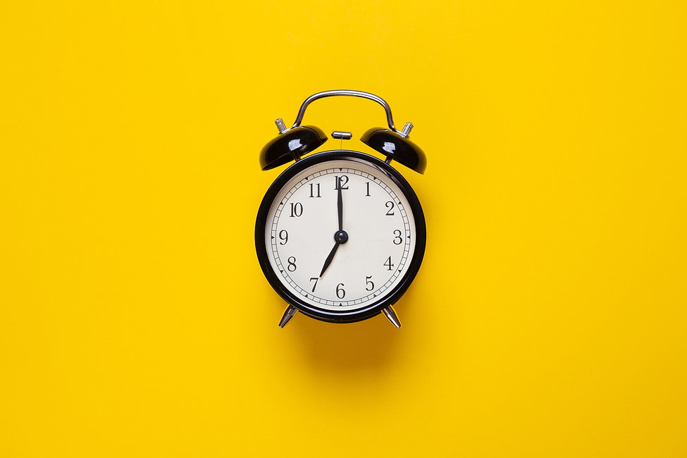 alarm-clock-shows-hour-yellow-background