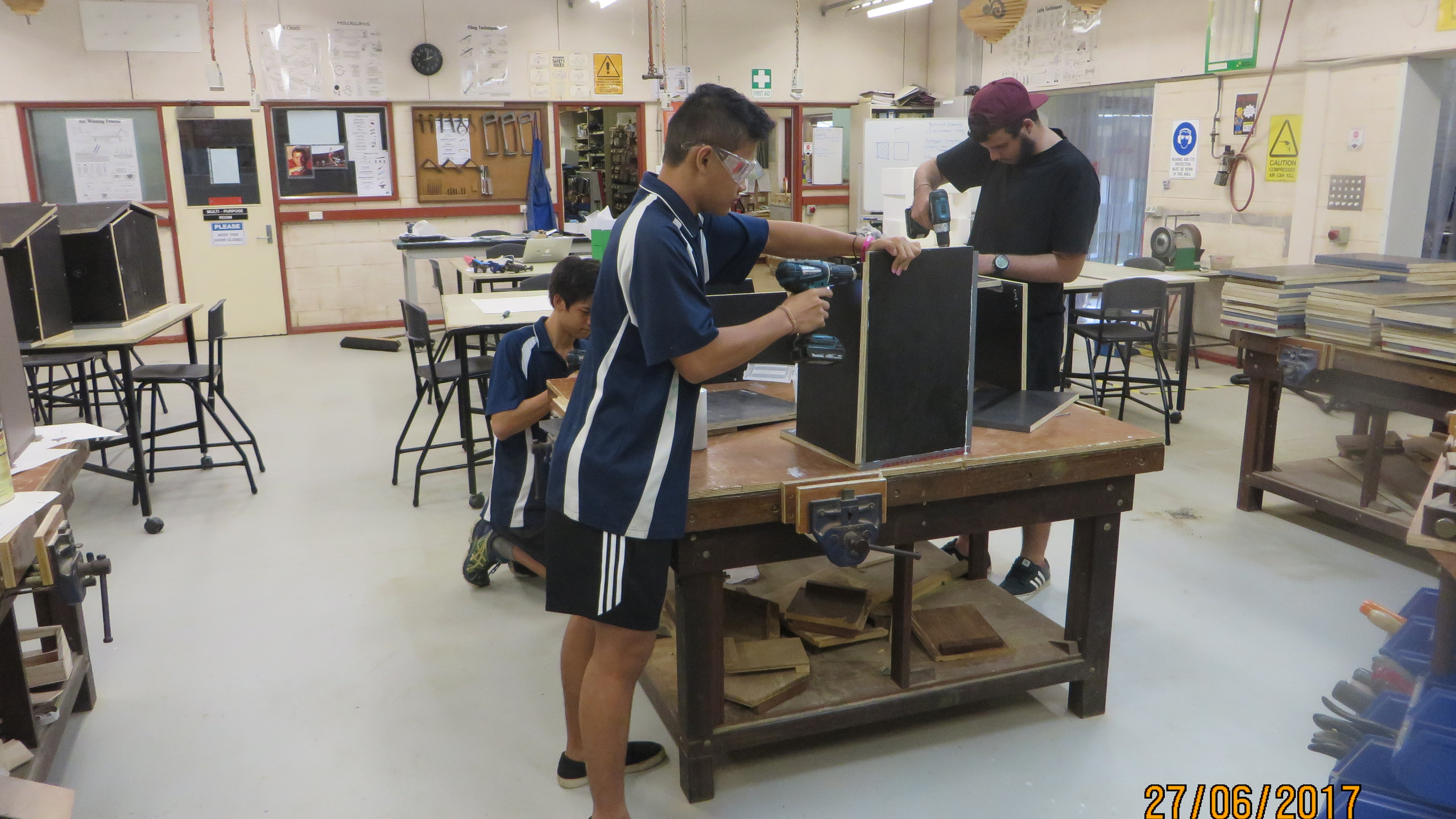 Students at Christmas Island High School students building nest boxes for Hawk-owls