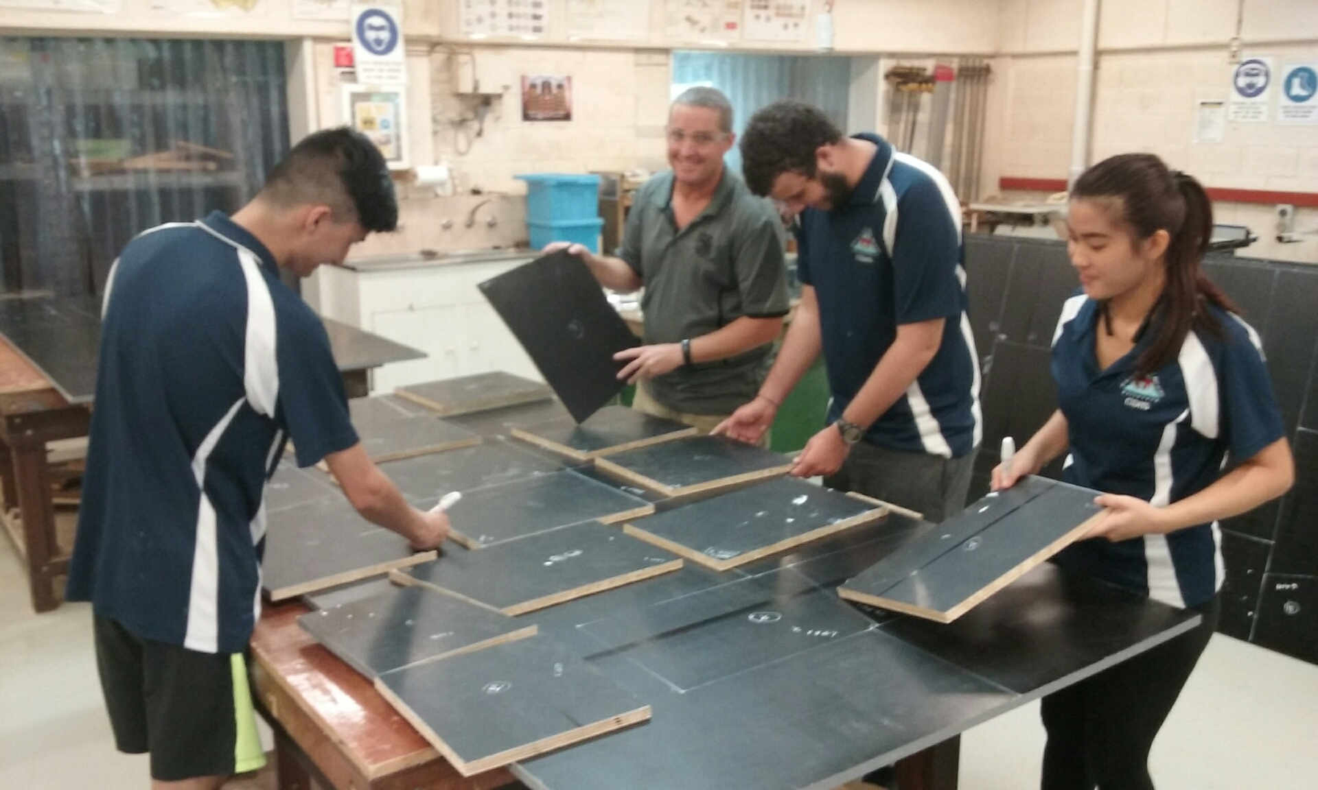 Mr Brad Boucher helping students at Christmas Island High School students build nest boxes