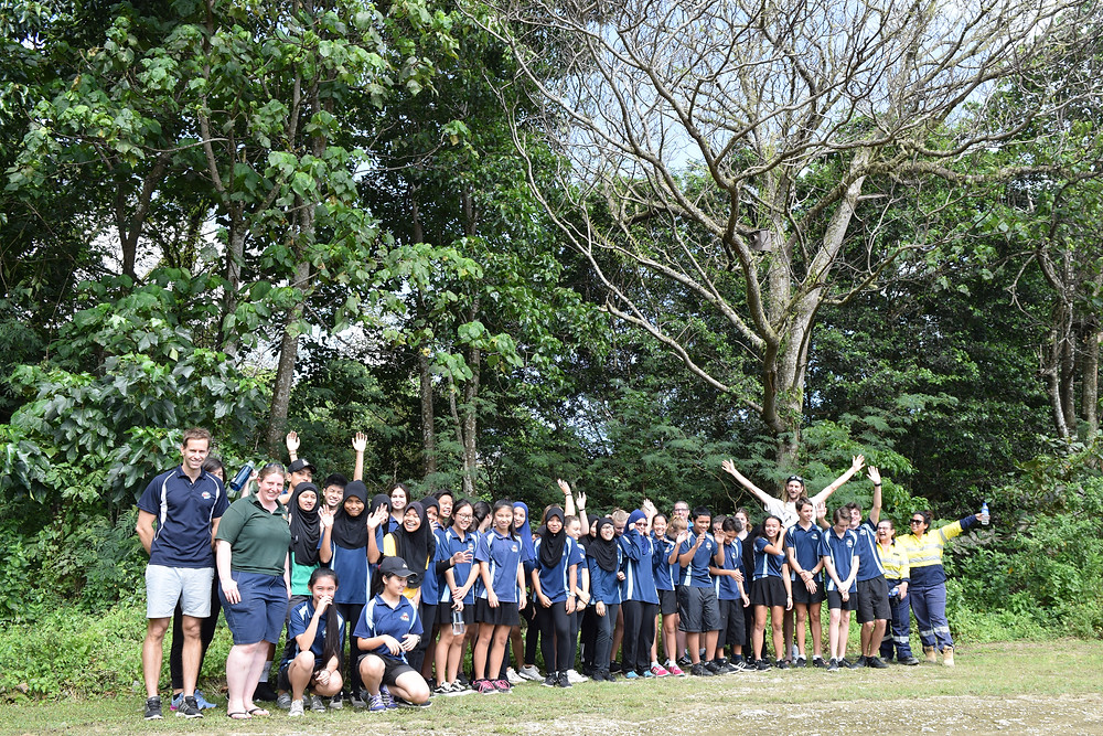 Christmas Island District High School students standing under a nest box installed on the school oval.