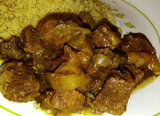 Tagine of goat with apricots, prunes, and honey