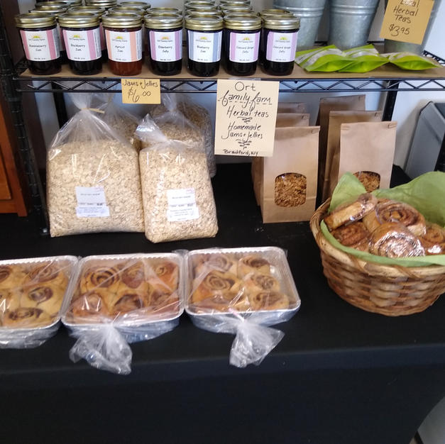 Jams and Jellies from Ort Family Farm, as well as cinnamon rolls, Granola, and rolled oats.