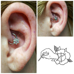 Daith piercing_ 16 gauge 5_16 captive bead ring and an added Prong Set Crystal Flower Internally Thr