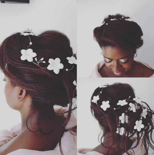 Bridal hair large bun with daisy vine