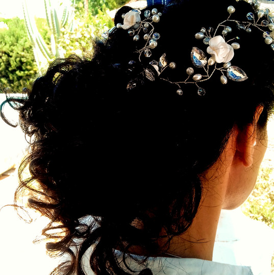 Bridal hair upstyle on curly hair