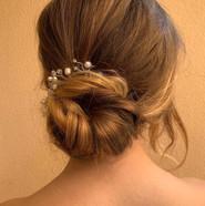Bridesmaid hairstyle low bun