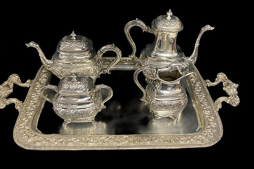 A large coffee and tea set with tray in the baroque manner silver