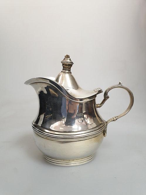 A portuguese sterling silver milk jug