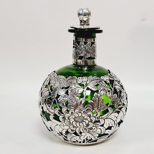A bottle glass and silver