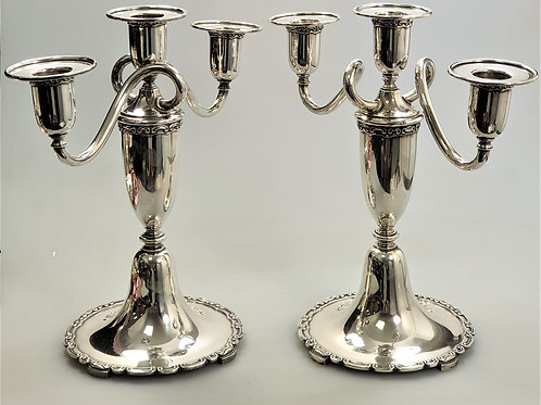 A pair of three-light candelabra portuguese silver