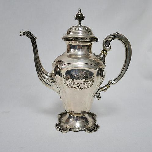 A Portuguese sterling silver coffee pot/ Cafeteira em prata portuguesa