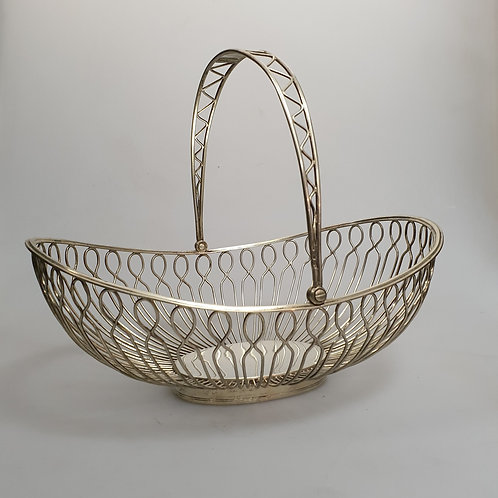 A Portuguese sterling silver basket articulated handle