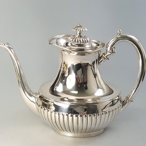 A portuguese silver coffee pot.