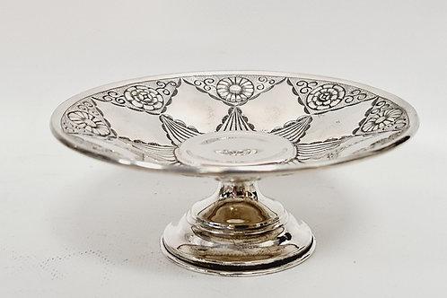 Silver salver on pedestal foot