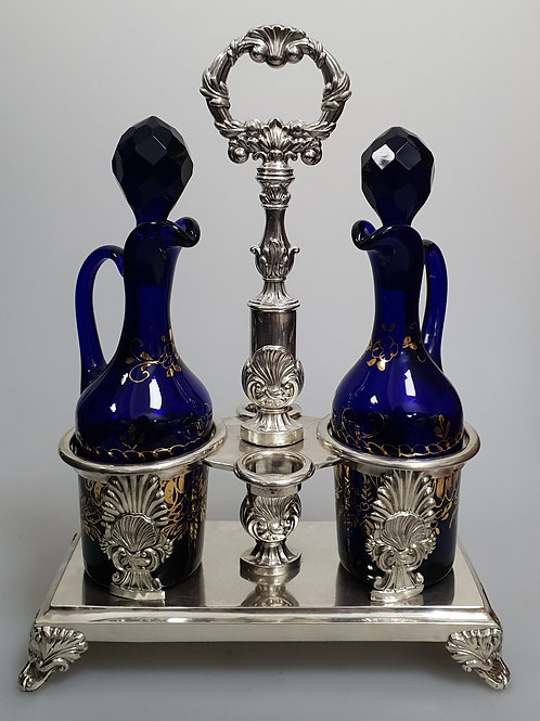 A french sterling silver cruet stand and pair of blue glass decanters