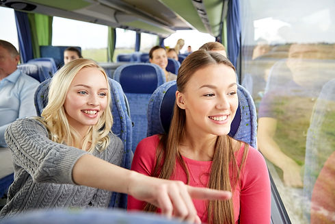 transport, tourism, friendship, road trip and people concept - young women or teenage frie