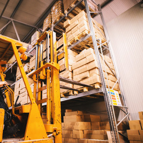 fork-lifter-approaching-pallet-filled-wi