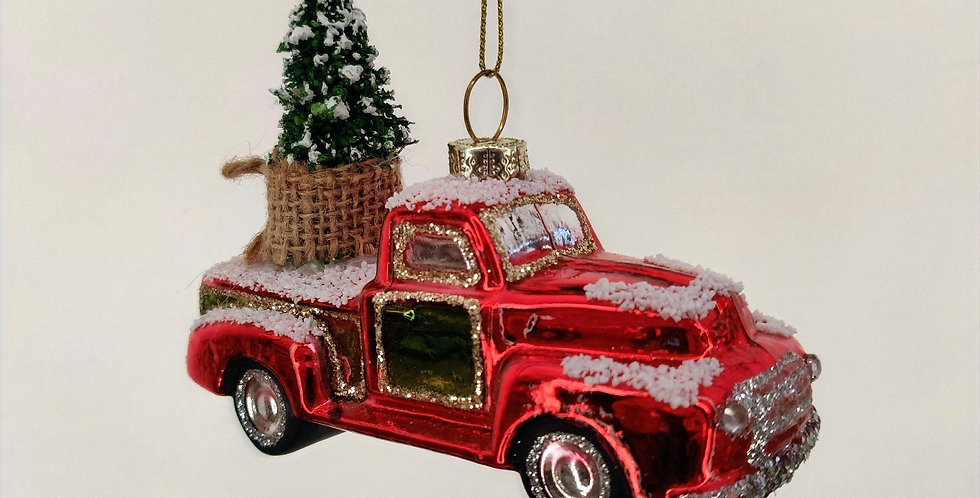 Snowy Red Pickup with Tree Ornament