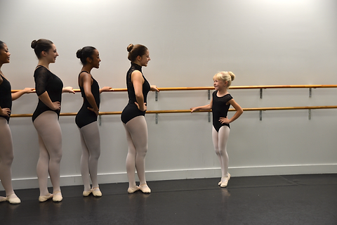 Toronto Dance Industry Inc. Senior Ballet class with young dancer at ballet bar