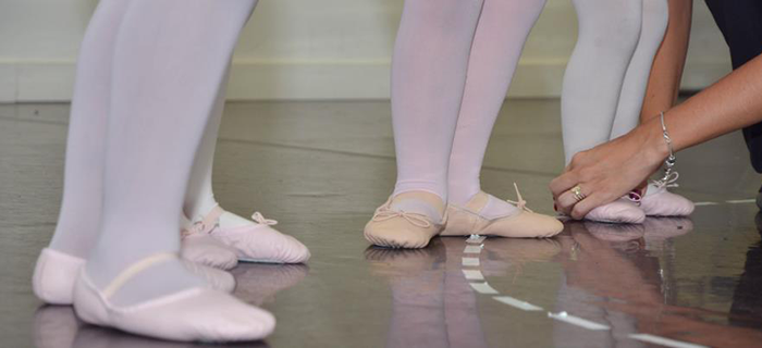Toronto Dance Industry Inc. dancers geting ready for class tying shoes
