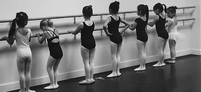 Toronto Dance Industry Inc. dancers warming up on ballet bar photo