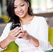 asian woman with phone tiny.jpg