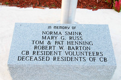 plaque at base of flag