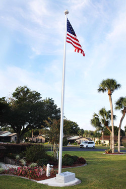 flag and plaque by clubhouse