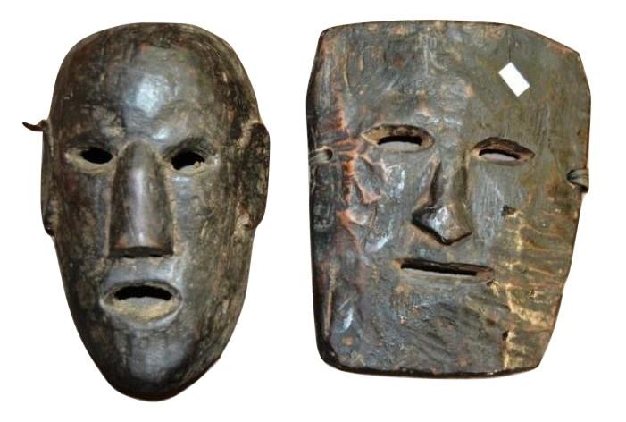 Carved tribal wooden masks