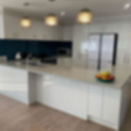 Here is a great example of some sleek lines on this modern style kitchen_edited.jpg