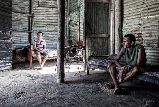 Limardo Soto (37) and Maikel Soto(11) dentro de la casa. Barranquitas, Zulia. Venezuela.2015