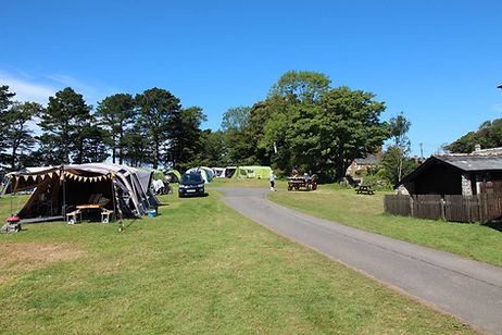 Trewan Hall campsite Cornwall, camping field with tents on a beautiful cornish summer day