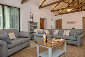 Trewan Hall campsite cornwall, Stables holiday home living room