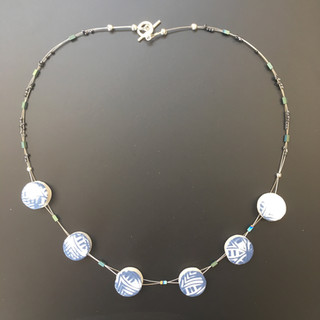 Necklace with handmade porcelain beads, £40 Please email or text Siglint Kessler 07730871780