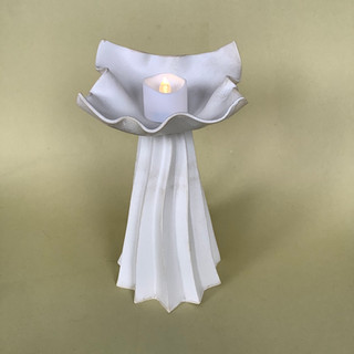 An elegant candle holder for your table or mantelpiece. H 22cm Slipcast porcelain £ 45 2x£90