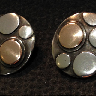 Large, Sterling silver and gold lichen clip earrings.  £130  Sterling silver earrings, gently domed oxidised background, with silver and gold spots in relief, 2cm diameter. With clip on earfittings.  Christine Savage 07966550936