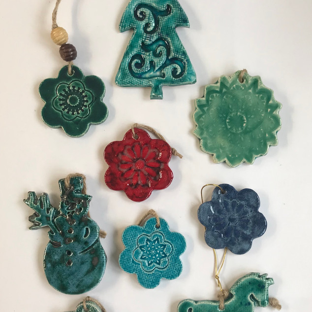 Najha Saleh Hanging Christmas Decorations Between £8 and £15 each Stoneware Clay, Glazed. Smallest size: approx. 6cm x 6cm Largest size: approx. 12cm x 6cm Various colours available in each design.