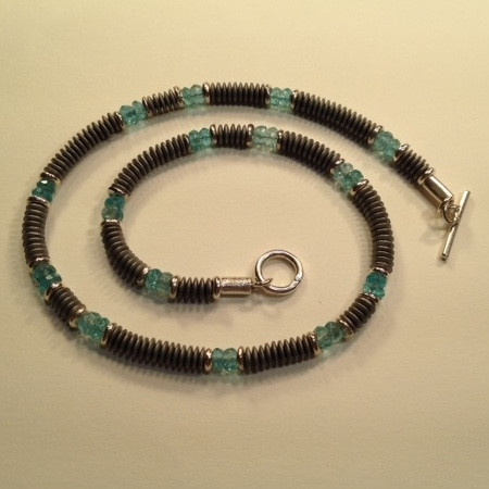 """Haematite, Apatite and Sterling silver necklace.  £220  Apatite, frosted Haematite and handmade silver beads and catch, make up this 16 1/4""""long necklace. This necklace can be made a touch longer or shorter within the price.  Christine Savage 07966550936"""